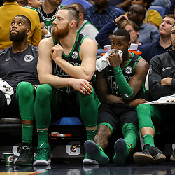 Mar 18, 2018; New Orleans, LA, USA; Boston Celtics Greg Monroe (left) and Aron Baynes and Terry Rozier Jayson Tatum (right) watch from the bench during the fourth quarter against the New Orleans Pelicans at the Smoothie King Center. Mandatory Credit: Derick E. Hingle-USA TODAY Sports