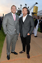 Left to right, JAMES HASKELL and PAUL DORAN-JONES at the Battersea Power Station Annual Party at Battersea Power Station, 188 Kirtling Street, London SW8 on 30th April 2014.