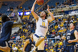 Nov 20, 2016; Morgantown, WV, USA; West Virginia Mountaineers forward Nathan Adrian (11) shoots in the lane during the second half against the New Hampshire Wildcats at WVU Coliseum. Mandatory Credit: Ben Queen-USA TODAY Sports