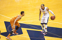 Jan 20, 2016; Morgantown, WV, USA; West Virginia Mountaineers guard Jevon Carter (2) dribbles across mid court during the first half against the Texas Longhorns at the WVU Coliseum. Mandatory Credit: Ben Queen-USA TODAY Sports