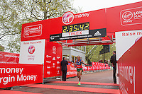 Aniceto Antonio Dos Santos of Brazil crosses the line to finish first in the IPC Athletics Marathon World Championships T13 race at the Virgin Money London Marathon, Sunday 26th April 2015.<br /> <br /> Scott Heavey for Virgin Money London Marathon<br /> <br /> For more information please contact Penny Dain at pennyd@london-marathon.co.uk