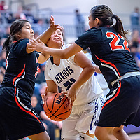 Gallup Bengals Leona Smith (33), left, and Lanae Notah Notah (22) collapse around driving Miyamura Patriot Tionna Tom (21) at Miyamura High School Thursday.