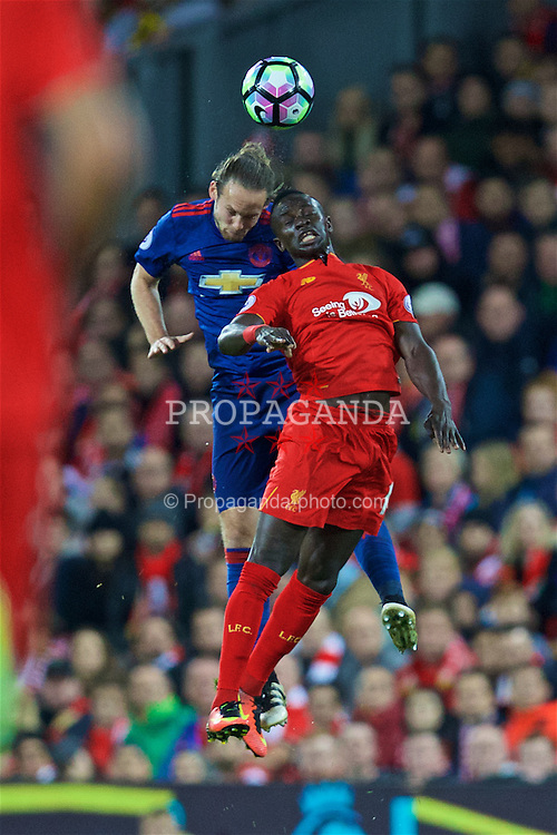 LIVERPOOL, ENGLAND - Monday, October 17, 2016: Liverpool's Sadio Mane in action against Manchester United's Daley Blind during the FA Premier League match at Anfield. (Pic by David Rawcliffe/Propaganda)