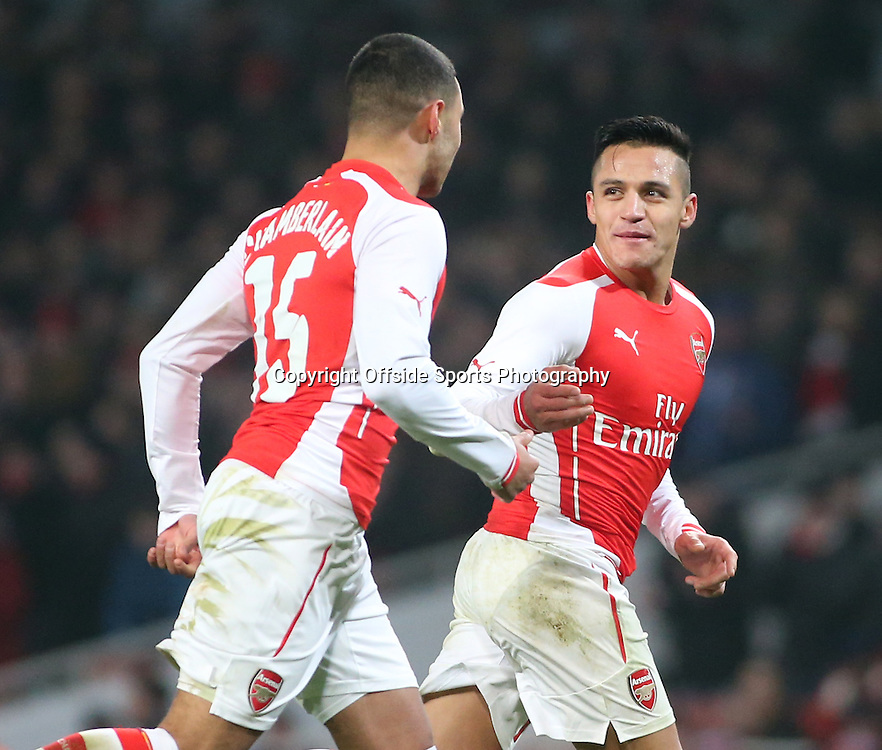 04 January 2015 - FA Cup Third Round - Arsenal v Hull City - Alexis Sanchez of Arsenal celebrates his goal with teammate Alex Oxlade Chamberlain.<br /> <br /> Photo: Ryan Smyth/Offside