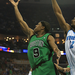11 February 2009:  Boston Celtics guard Rajon Rondo (9) shoots over New Orleans Hornets center Hilton Armstrong (12) during a NBA game between the Boston Celtics and the New Orleans Hornets at the New Orleans Arena in New Orleans, LA.