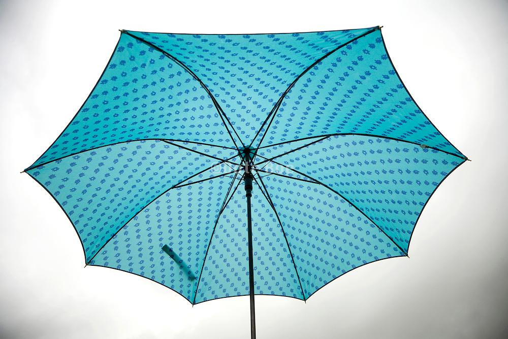 umbrella against a gray sky