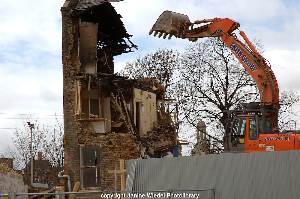 Lambeth Council digger demolishing the last remaining house Negusa Negast-3  from St Agnes Place Kennington a street in South London squatted for 30 years 13 April 2006.