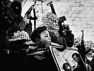 Young Fatah members at the funeral of a martyr from the City Inn front. The children learn the political views of the adults from an early age. <br /> Sep./Nov. 2002. The separation wall goes thru the israeli/palestinian countries as a snake and a constant reminder of the state of the country.