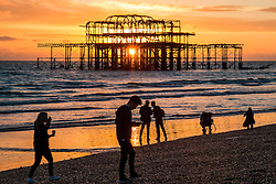 © Licensed to London News Pictures. 28/10/2015. Brighton, UK. Brighton's West Pier stands against a dramatic and colourful sunset. Today October 28th 2015. Photo credit : Hugo Michiels/LNP