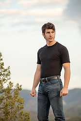 sexy man outdoors in a black tee shirt