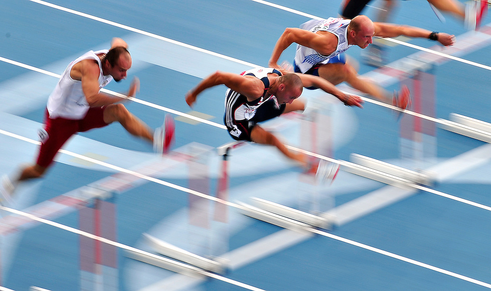 Great Britain's Andy Turner (C) competes to take the first place in the first round heat 2 of the men's 110m hurdles at the 2010 European Athletics Championships at the Olympic Stadium in Barcelona on July 29, 2010.