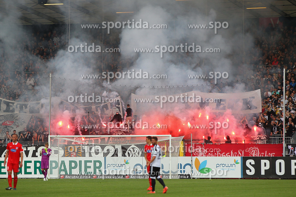 17.05.2015, Scholz Arena, Aalen, GER, 2. FBL, VfR Aalen vs 1. FC Heidenheim, 33. Runde, im Bild VfR Aalen Fans brennen mehrere Bengalos ab // during the 2nd German Bundesliga 33th round match between VfR Aalen and 1. FC Heidenheim at the Scholz Arena in Aalen, Germany on 2015/05/17. EXPA Pictures &copy; 2015, PhotoCredit: EXPA/ Eibner-Pressefoto/ Langer<br /> <br /> *****ATTENTION - OUT of GER*****