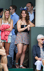 LONDON, ENGLAND - Monday, June 30, 2014: A spectator during the Girls' Singles 1st Round match on day seven of the Wimbledon Lawn Tennis Championships at the All England Lawn Tennis and Croquet Club. (Pic by David Rawcliffe/Propaganda)