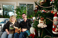 Patty and Jerry Woodbury with a terrarium they made in an art class, photographed at their home in Kettering, joined by thier dog Bondi, Saturday, December 22, 2012.