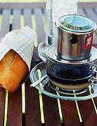 Breakfast of Vietnamese iced coffee (cà phê s?a ?á) and French baguette.