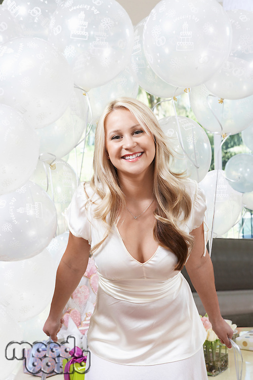 Smiling Bride Holding Balloons at Bridal Shower