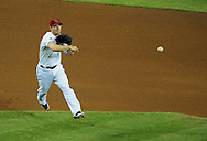 Jul. 17 2011; Phoenix, AZ, USA; Arizona Diamondbacks infielder Stephen Drew (6) throws the ball against the Los Angeles Dodgers at Chase Field. The Dodgers defeated the Diamondbacks 6-4.  Mandatory Credit: Jennifer Stewart-US PRESSWIRE.