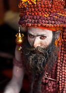Sadhu with Rudraksha Mala during Maha Kumbh Mela, a festival known as world's largest congregation of religious pilgrims. Allahabad, India.