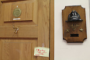 """26 February 2013. Bronx, New York. Engine Co. 73/Hook & Ladder 42 at 655-659 and 661 Prospect Ave., the Bronx. Lieutenant Richard Nash's door features a note from his young daughter, Catie, reading """"Hey dad clean your locker."""" 2/26/13. Photograph by Nathan Place/CUNY Journalism Photo."""