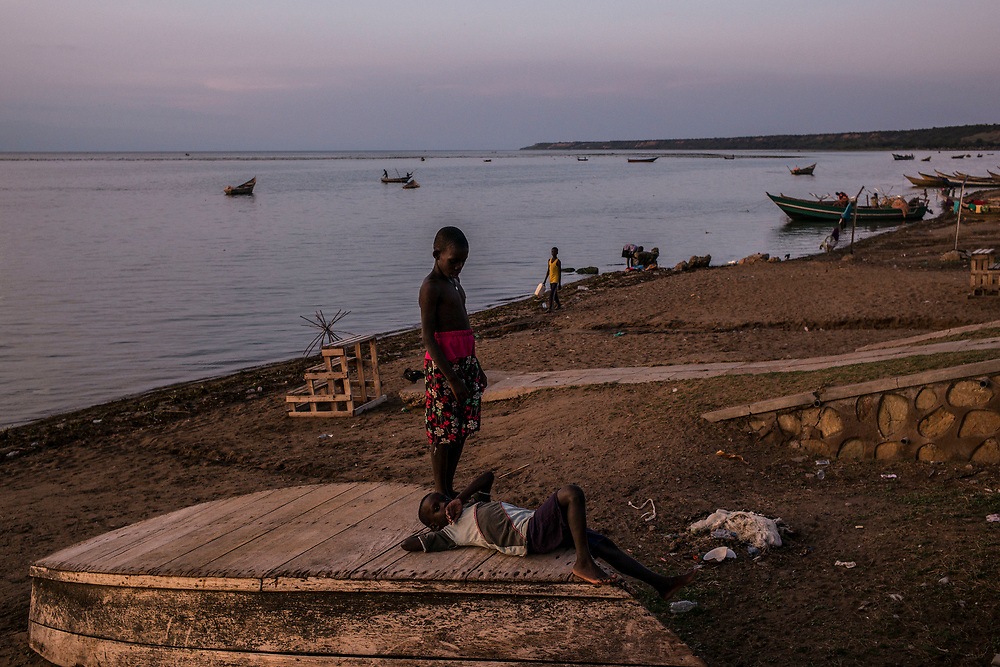 SEBAGORO, UGANDA - MARCH 22: Children play on boats on the shore in Sebagoro, one of the main landing sites for refugees fleeing across Lake Albert, in Sebagoro, Uganda on March 22, 2018. Violence in Ituri Province in northeastern Democratic Republic of Congo has displaced more than 100,000 people including approximately 40,000 refugees who have fled to Uganda. (Photo by Andrew Renneisen for The Washington Post)