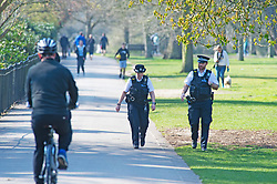 ©Licensed to London News Pictures 27/03/2020  <br /> Greenwich, UK. Police on Covid-19 patrol. Sunny spring weather as people get out of the house from Coronavirus lockdown to exercise in Greenwich Park, London. The Prime Minister Boris Johnson has asked people to stay at home to help in the fight against Covid-19 and to only go out for essential reasons. credit:Grant Falvey/LNP