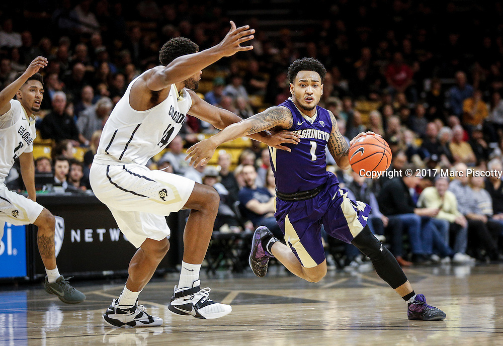 SHOT 2/9/17 10:12:51 PM - Washington's David Crisp #1 drives the lane in front of Colorado's Tory Miller #14 during their regular season Pac-12 college basketball game at the Coors Events Center in Boulder, Co. Colorado won the game 81-66. (Photo by Marc Piscotty / © 2017)