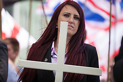 Luton, UK. 27th June, 2015. Britain First's deputy leader Jayda Fransen leads members of the far-right group on a march through Luton. Police failed to prevent the leaders from attending the march, but ensured that they could not carry banners demanding no more mosques. A counter-protest was organised by Unite Against Fascism.