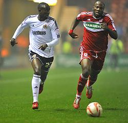 Bristol City's Albert Adomah takes the ball past Middlesbrough's Andre Bikey - Photo mandatory by-line: Joe Meredith/JMP  - Tel: Mobile:07966 386802 24/11/2012 - Middlesbrough v Bristol City - SPORT - FOOTBALL - Championship -  Middlesbrough  - River Side Stadium