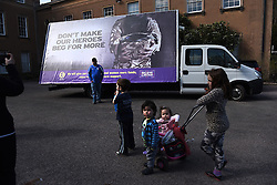 "© London News Pictures. ""Looking for Nigel"". A body of work by photographer Mary Turner, studying UKIP leader Nigel Farage and his followers throughout the 2015 election campaign. PICTURE SHOWS - A family has their photographs taken in front of a UKIP billboard inveiled at Himley Hall, Dudley on April 7th 2015 as Nigel Farage and his team toured the Midlands mid-campaign. . Photo credit: Mary Turner/LNP **PLEASE CALL TO ARRANGE FEE** **More images available on request**"