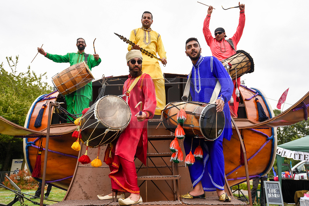 © Licensed to London News Pictures. 18/08/2018. LONDON, UK. Drummers perform on the largest Dhol drum in the world at the ZEE London Mela, in Southall Park near to Europe's oldest Asian community in Southall, west London. Now in its 16th year, the weekend festival includes music, dance and cultural activities, inspired by South Asia and the diaspora.  Photo credit: Stephen Chung/LNP