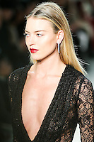 Martha Hunt walks the runway wearing Cushnie et Ochs Fall 2016, hair by Antonio Corral Calero for Moroccanoil, makeup by Val Garland, photographed by Thomas Concordia during New York Fashion Week on February 12, 2016