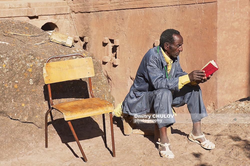 LALIBELA, ETHIOPIA - JANUARY 27, 2010: Unidentified man reads book in Lalibela, Ethiopia. Ethiopia has one of the highest levels of illiteracy in the world.