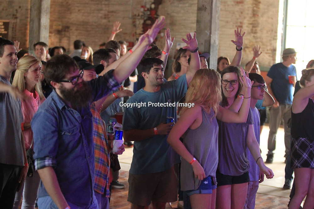 """Those in attendance at """"Music at the Mill"""" dance to the tunes of """"Silas"""" to kick off the Elvis Festival Thursday night. This is the Tupelo Cotton Mill's first event that featured all Mississippi-native singers/bands."""