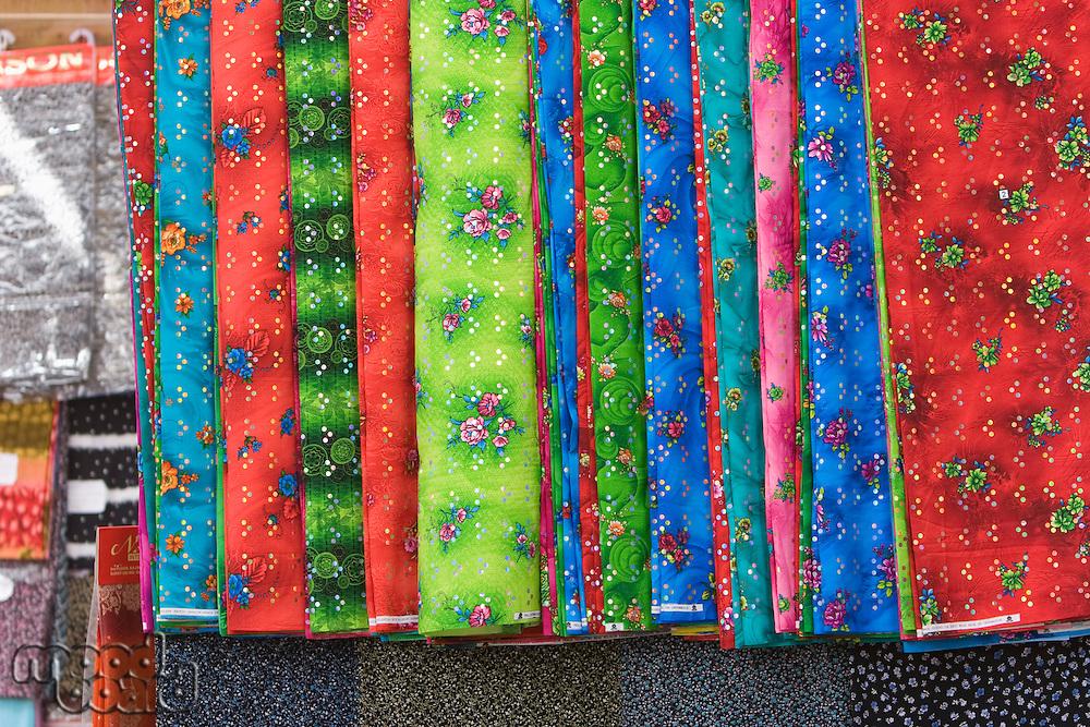 Dubai UAE Bright colored fabrics are for sale in the Bur Dubai souq.