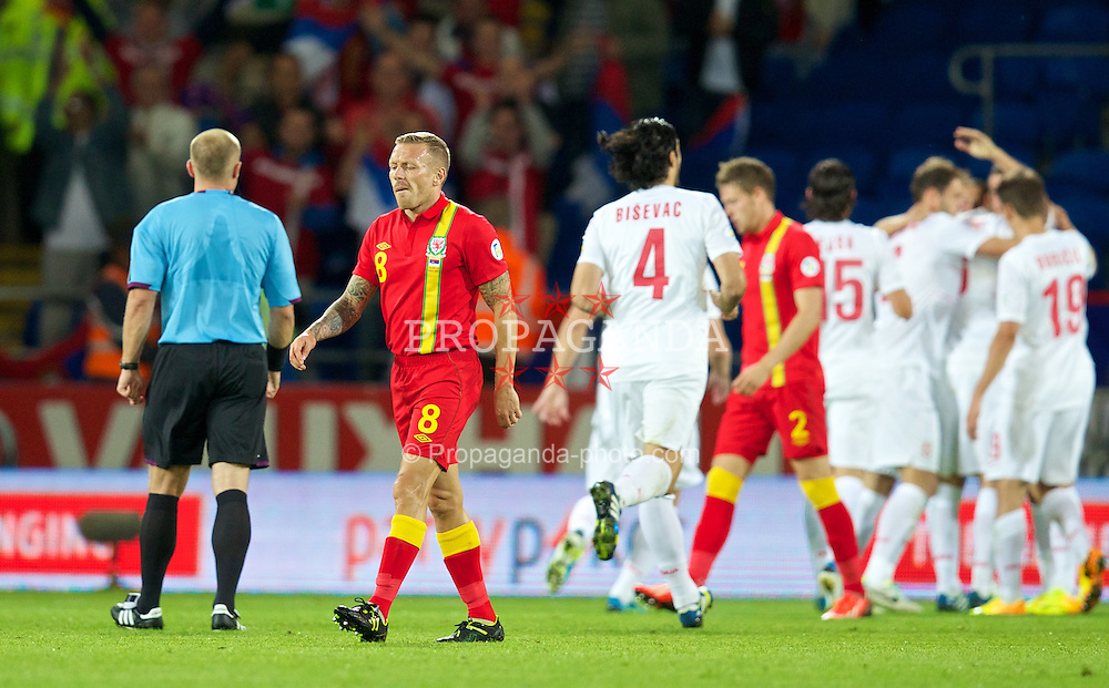 CARDIFF, WALES - Tuesday, September 10, 2013: Wales' Craig Bellamy looks dejected after Serbia score the third goal during the 2014 FIFA World Cup Brazil Qualifying Group A match at the Cardiff CIty Stadium. (Pic by David Rawcliffe/Propaganda)