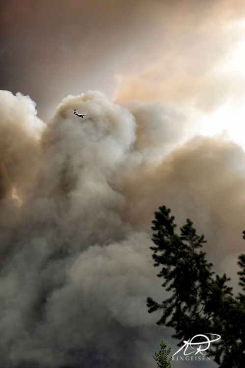 September 12, 2015 - Lake County, California, Firefighting aircraft attacking the Valley Fire as it races through Boggs Mountain State Forest, observed from Loch Lomond (Kim Ringeisen / Polaris)