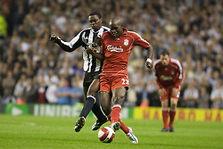 LIVERPOOL, ENGLAND - WEDNESDAY, SEPTEMBER 20th, 2006: Liverpool's Momo Sissoko and Newcastle United's Shola Ameobi during the Premiership match at Anfield. (Pic by David Rawcliffe/Propaganda)