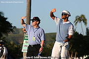 American actor and comedian Will Smith and his caddy Todd Biersch look down the fairway during the Pro-Am event at The 2005 Sony Open In Hawaii. The event was held at The Waialae Country Club in Honolulu.