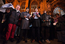 "© Licensed to London News Pictures. 17/11/2015. Bristol, UK.  Vigil for the victims of the Paris terrorist attacks at Bristol Cathedral.  Bristol's elected Mayor George Ferguson (left in red trousers) joins Religious and community leaders. The Muslim community in Bristol organised a candle-lit vigil for all faiths and backgrounds at Bristol Cathedral to show solidarity with the victims of the Paris attacks which are claimed by IS (Islamic State).  The management and Imaam's of Bristol's Easton Jamia Masjid, Bristol's biggest mosque, released a statement saying they have been shocked and saddened by the attacks on innocent people in France. ""We strongly condemn the terrorist atrocities in France, these sickening crimes are an attack against all of humanity.  As a local Muslim place of worship we send our condolences from our local community and congregation to the people of France.  During this very dark hour they will see compassion and solidarity from around the world"".  Photo credit : Simon Chapman/LNP"