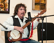 Rick Ward plays a Banjo cut out by his late grandfather and assembled by he and his dad