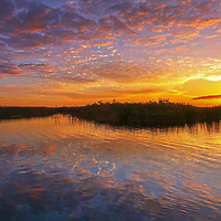 South Florida sunset panorama photography from nature photographer Juergen Roth showing a magical sunset at Loxahatchee National Wildlife Refuge located west of Boynton Beach in Palm Beach County, FL. Arthur R. Marshall Loxahatchee National Wildlife Refuge is an incredible nature area for viewing wildlife and landscape photography in Florida. <br />