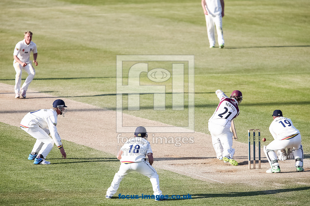 Rob Newton of Northamptonshire County Cricket Club (2nd right) defending during day 4 of the LV County Championship Div One match at the County Ground, Northampton<br /> Picture by Andy Kearns/Focus Images Ltd 0781 864 4264<br /> 16/04/2014