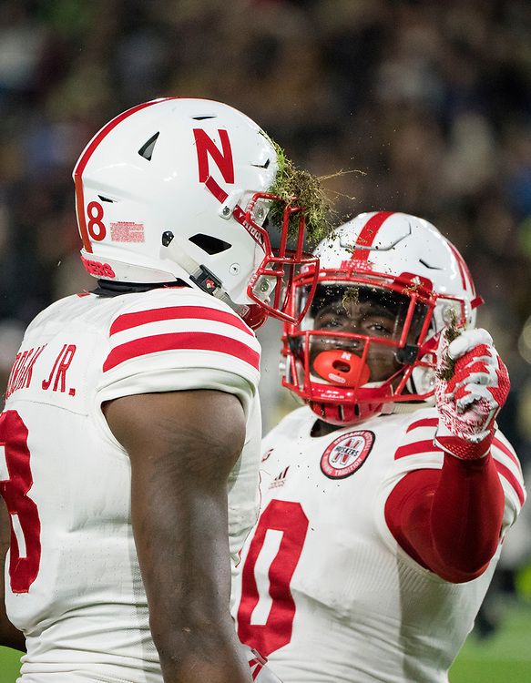 Nebraska Cornhuskers wide receiver JD Spielman #10 pull sod out of the helmet of Stanley Morgan Jr. #8 during Nebraska's win against Purdue at Ross-Ade Stadium in West Lafayette, Indiana on Oct. 28, 2017. Photo by Aaron Babcock, Hail Varsity