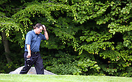 Phil Mickelson of the US walks up the fifteenth hole during the first day of the US Open Golf Championship at Winged Foot Golf Club in Mamaroneck, New York Thursday, 15 June 2006.