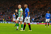 Alfredo Morelos of Rangers FC and Celtic Captain Scott Brown during the Betfred Scottish League Cup Final match between Rangers and Celtic at Hampden Park, Glasgow, United Kingdom on 8 December 2019.