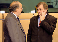 Pedro Solbes, Spain's finance minister, left, speaks with Jeannot Krecke, Luxembourg's minister of economy and foreign trade, during the EuroGroup conference, a meeting of finance ministers from the euro zone, Monday, Dec. 1, 2008, in Brussels, Belgium.  (Photo © Jock Fistick)