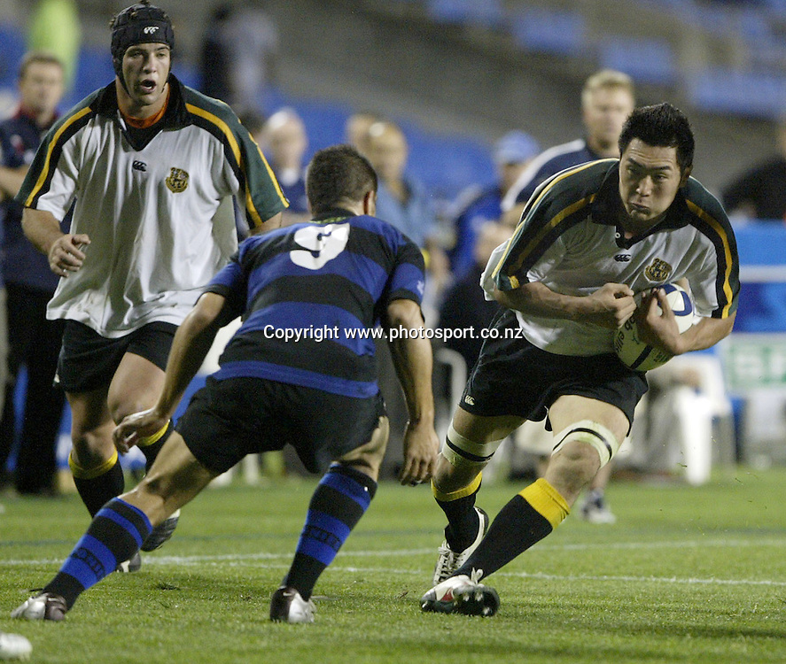 Grammar Carlton flanker Shiroji Ito eyes up Chad Tuoro during the rugby union club match between Grammar Carlton and Ponsonby, at Eden Park, Auckland, on Friday 6 May, 2005. Photo: Michael Bradley/PHOTOSPORT<br />
