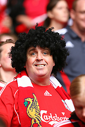 CARDIFF, WALES - SUNDAY, AUGUST 13th, 2006: Liverpool fan wearing a wig during the Community Shield match against Chelsea at the Millennium Stadium. (Pic by David Rawcliffe/Propaganda)