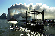 New York Waterway ferries evacuate survivors from the World Trade Center after the first tower collapsed on 09/11/01.