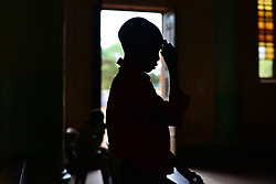 July 4, 2017 - Wau, Wau, South Sudan - A South Sudanese  IDP boy prays at the St. Mary Help Christian Cathedral during the daily morning service led by Father Marko Mangu, who is responsible for the diocese covering the town of Wau.Since clashes between rebels and government forces broke out last year, the churchreceived nearly 22 thousand refugees, mostly  farmers who ran from Dinka tribal militias from the northern areas of War-Awar. (Credit Image: © Miguel Juarez Lugo via ZUMA Wire)